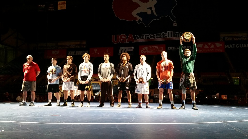 Awards Presentaion on the Mat, Coach Hanson handed out the awards for this weight class